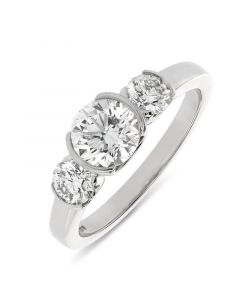 Platinum brilliant round cut diamond three stone engagement ring. 1.00cts