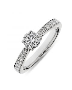 Platinum brilliant round cut single stone ring with diamond shoulders. 0.55cts