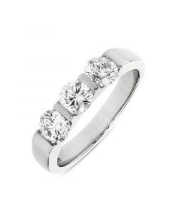 Platinum brilliant round cut diamond three stone engagement ring. 1.06cts