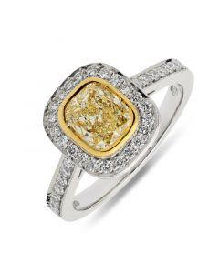Platinum cushion cut yellow diamond halo engagement ring. 1.01cts