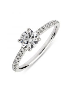 Platinum brilliant round cut single stone ring with diamond shoulders. 0.63cts