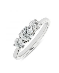 Platinum brilliant round cut diamond three stone engagement ring. 0.53cts