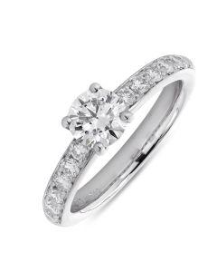 Platinum brilliant round cut single stone ring with diamond shouldrs. 0.70cts