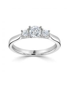 Platinum brilliant round cut diamond three stone engagement ring. 0.57cts