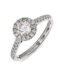 Platinum brilliant round cut diamond halo engagement ring. 0.54cts