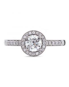 Platinum brilliant round cut diamond halo engagement ring. 0.57cts