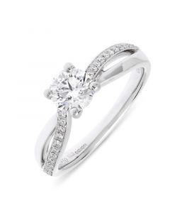 Platinum brilliant round cut diamond twist engagement ring. 0.70cts