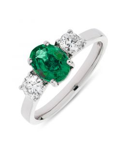 Platinum oval cut emerald and brilliant round cut side stones engagement ring. 1.20cts