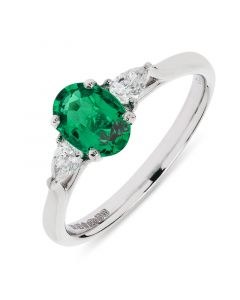 Platinum oval cut emerald with pear cut diamonds engagement ring. 0.71cts