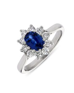 Platinum oval cut sapphire and diamond cluster engagement ring. 1.10cts