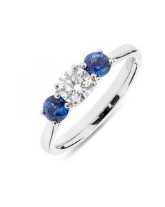 Platinum brilliant round cut diamond and sapphire engagement ring. 0.53cts