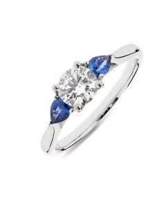 Platinum brilliant round cut diamond and sapphire engagement ring. 0.61cts